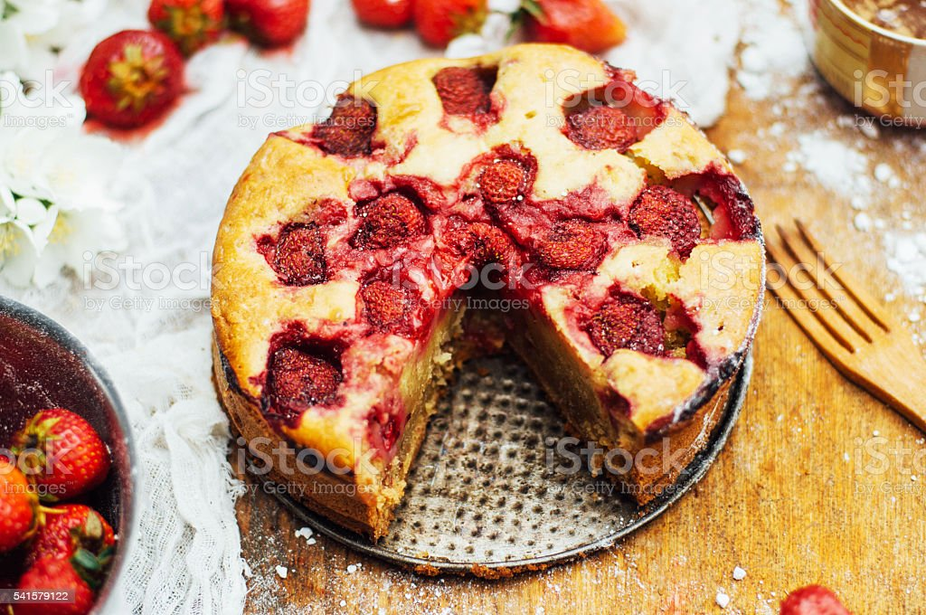 Serving homemade strawberry cake or pie stock photo