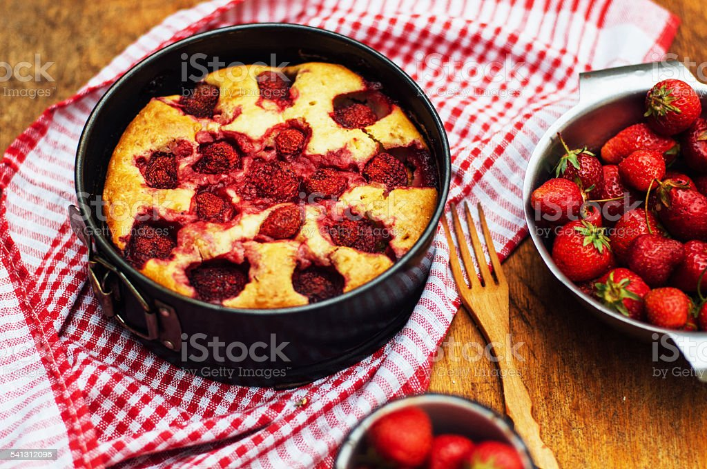 Serving homemade strawberry cake stock photo