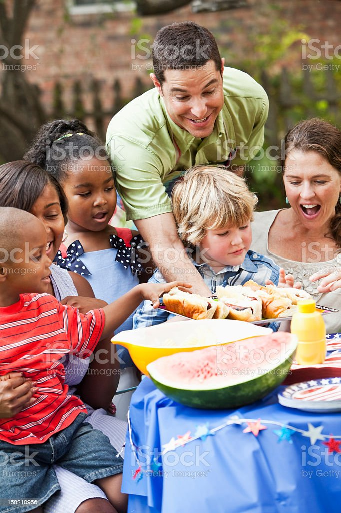 Serving hotdogs at cookout stock photo