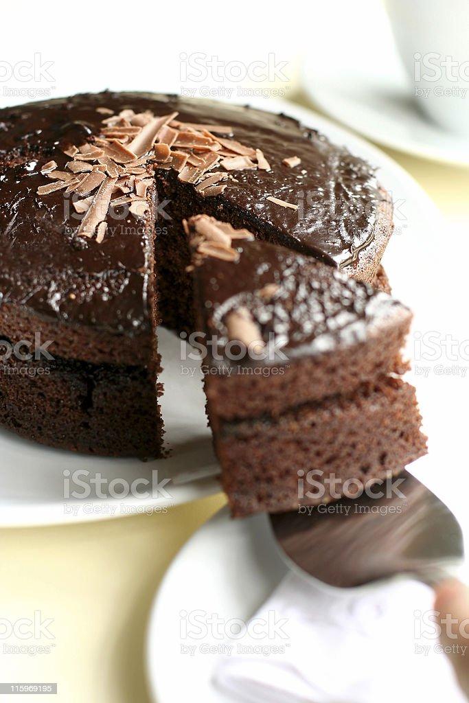 Serving iced chocolate cake stock photo