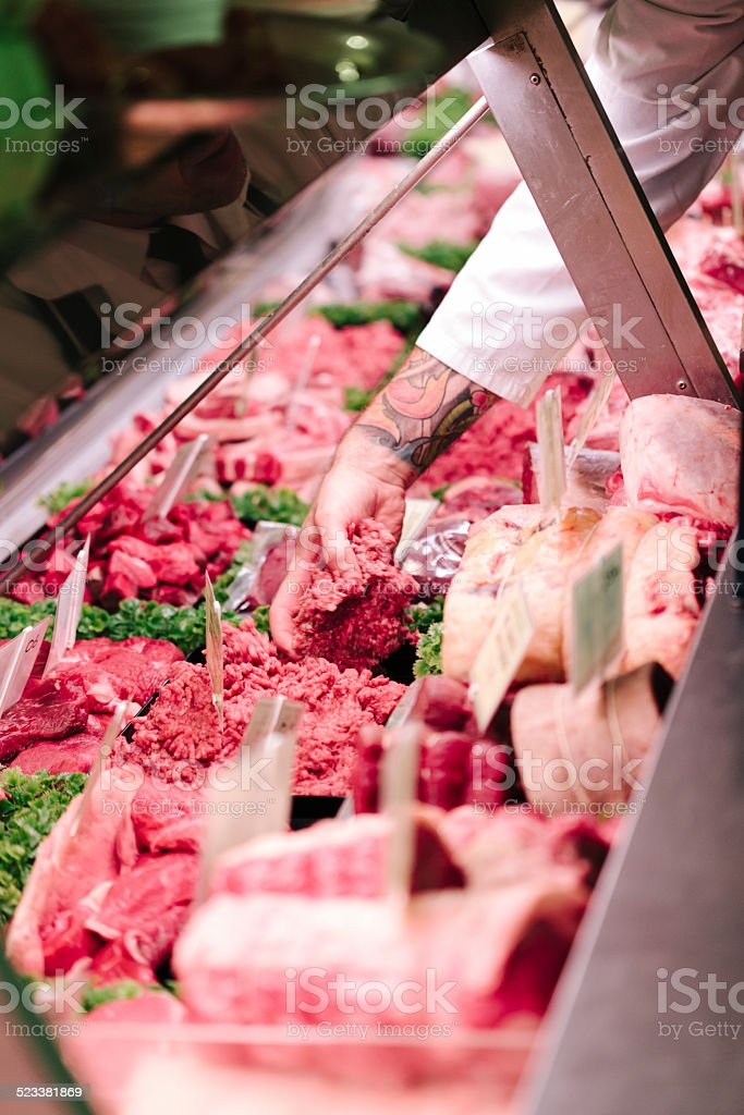 Serving in a Butcher's Shop stock photo