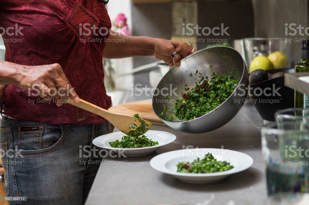 serving kale salad stock photo