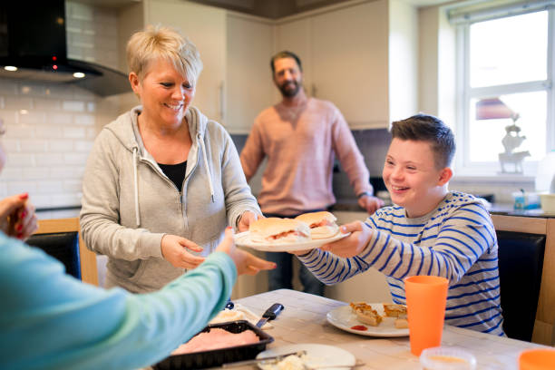 serving lunch at home - day in the life series stock pictures, royalty-free photos & images