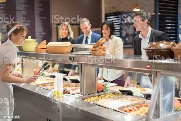 Serving lunch in cafetreria picture id657021234?b=1&k=6&m=657021234&s=612x612&h=j5wumfmta8qnpn 5kvpzi lokl3mvwvemg ydp7oyn4=