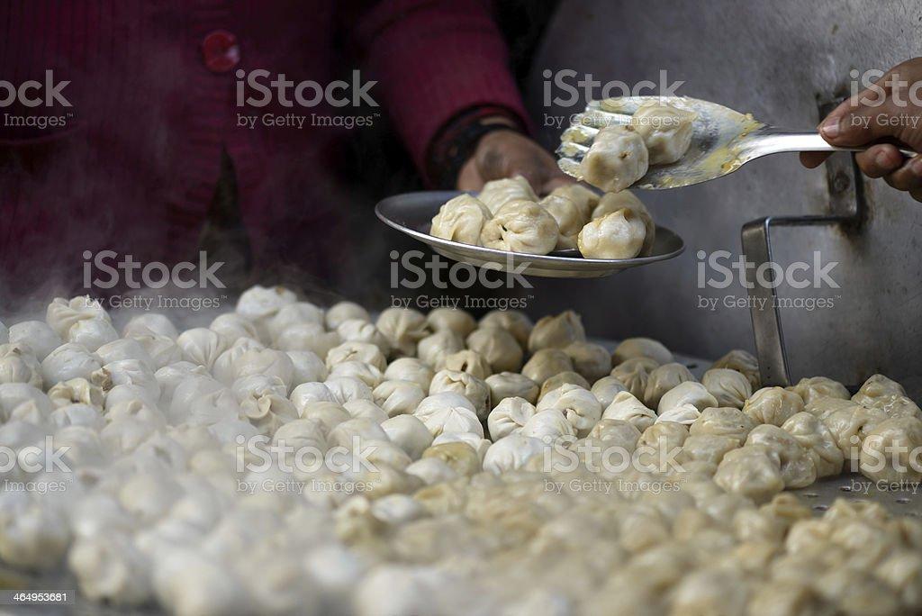 Serving nepalese momos stock photo