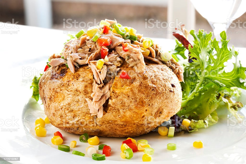Serving of baked potato with tuna and vegetable filling stock photo