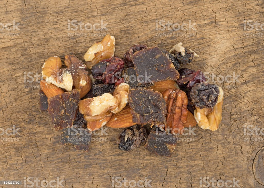 Serving of beef jerky trail mix on a board royalty-free stock photo