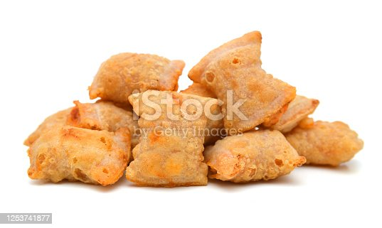 A serving of bite size pizza rolls isolated on a white background.