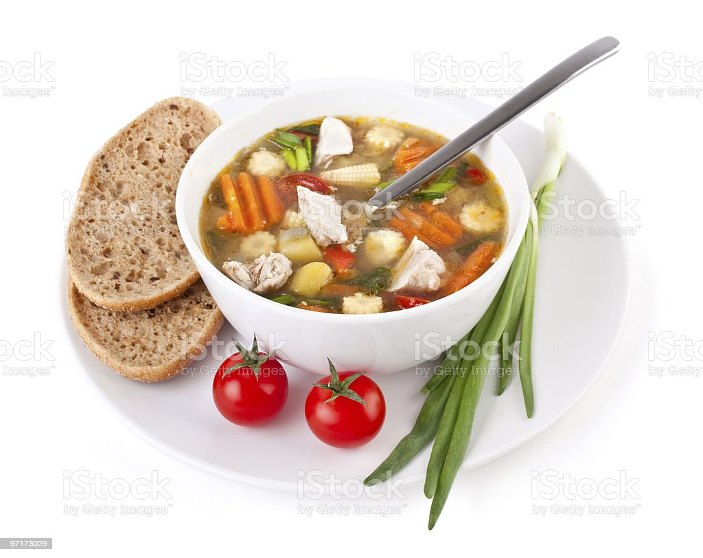 serving of chicken and vegetable soup stock photo