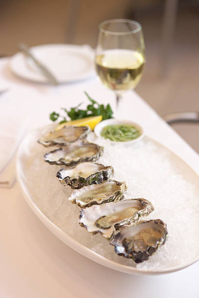 Serving of fresh oysters stock photo