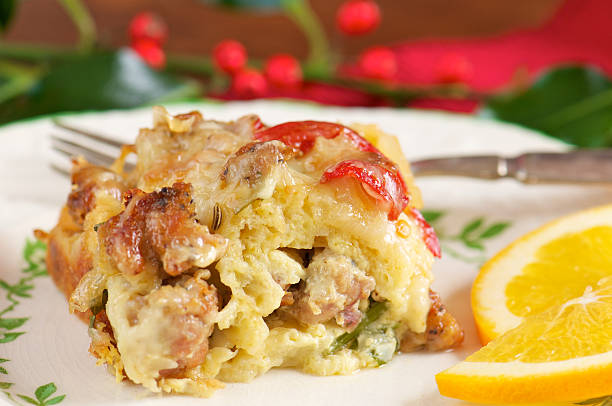 serving of sausage breakfast casserole - casserole stock photos and pictures