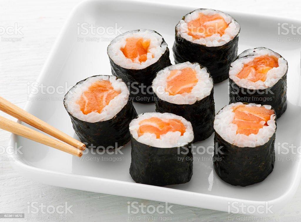 Serving of seven hosomaki salmon sushi stock photo