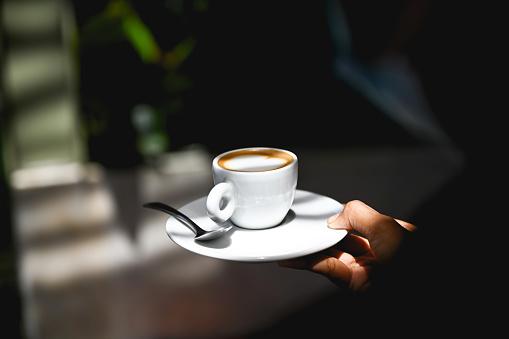 Unrezognizable wait staff serving perfect cup of cappuccino, Nikon Z7