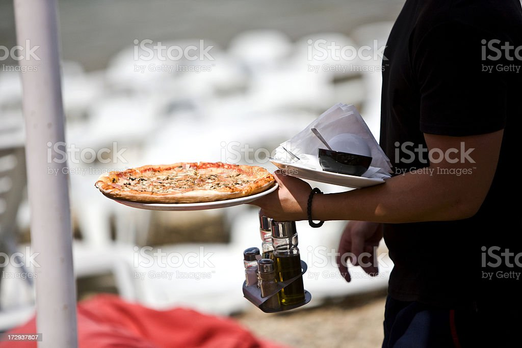Serving pizza royalty-free stock photo