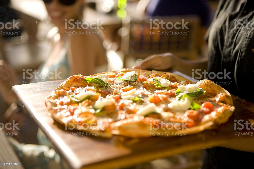Serving pizza stock photo