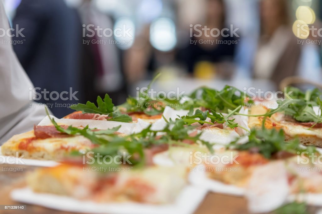 Serving pizza slices stock photo