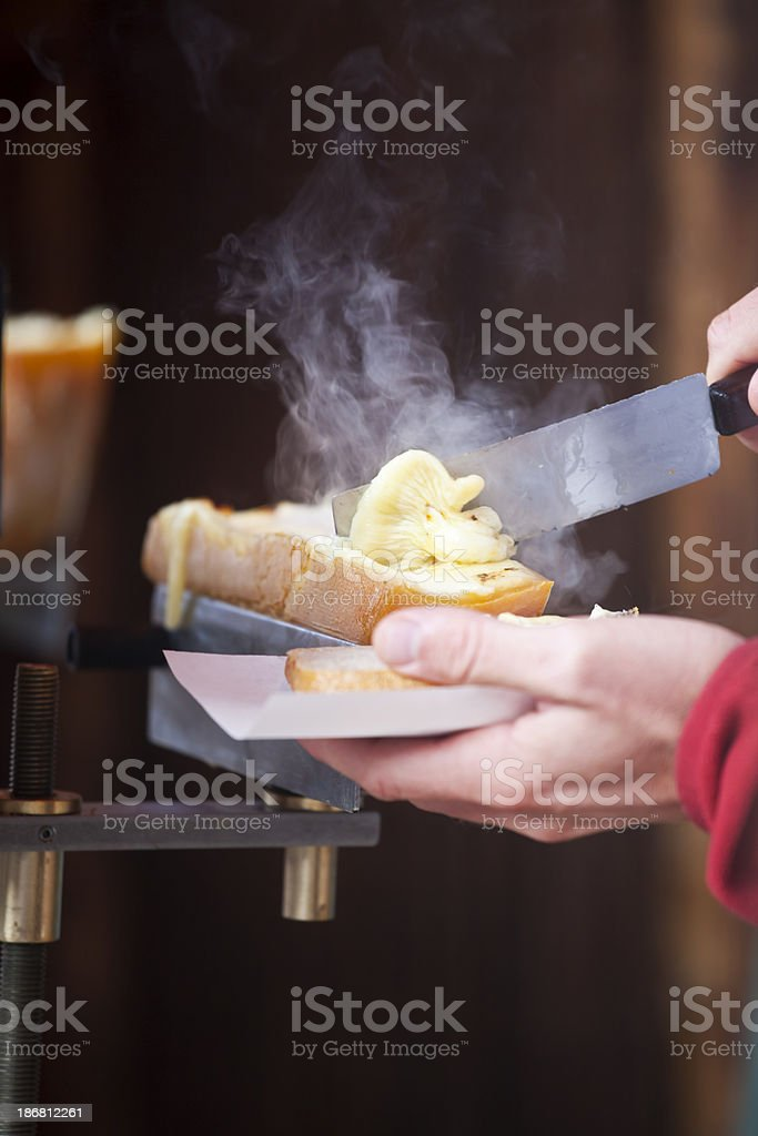 Serving Raclette stock photo