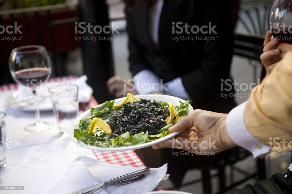 Serving risotto royalty-free stock photo