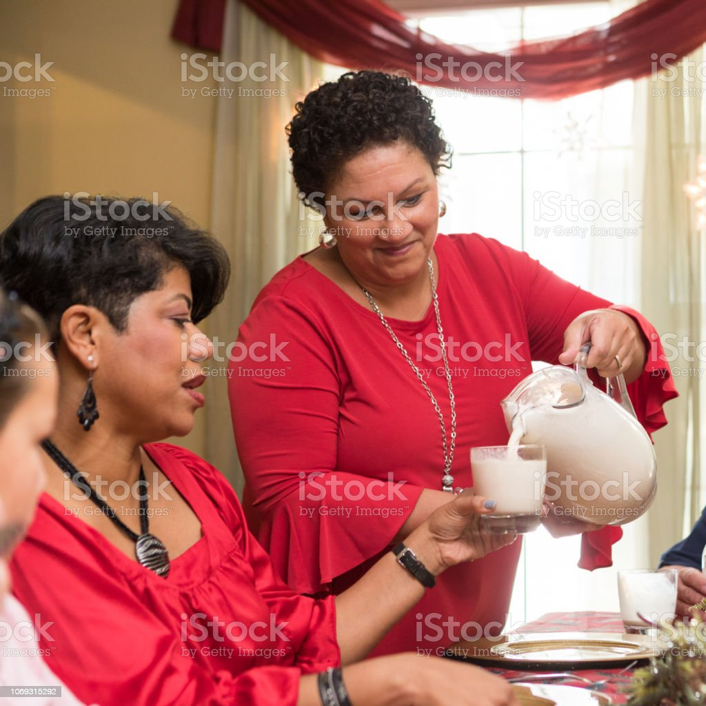 serving the traditional Puerto Rican drink coquito stock photo