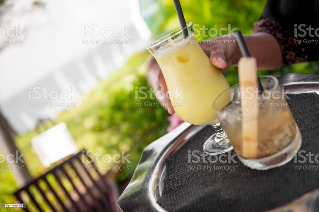 Serving tropical drinks stock photo