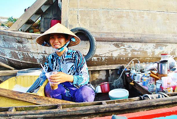 Serving Vietnamese Coffee Afloat The Mekong Delta stock photo