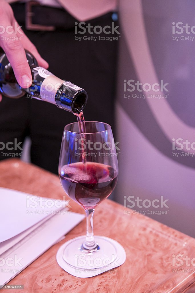 Serving wine on a flight royalty-free stock photo