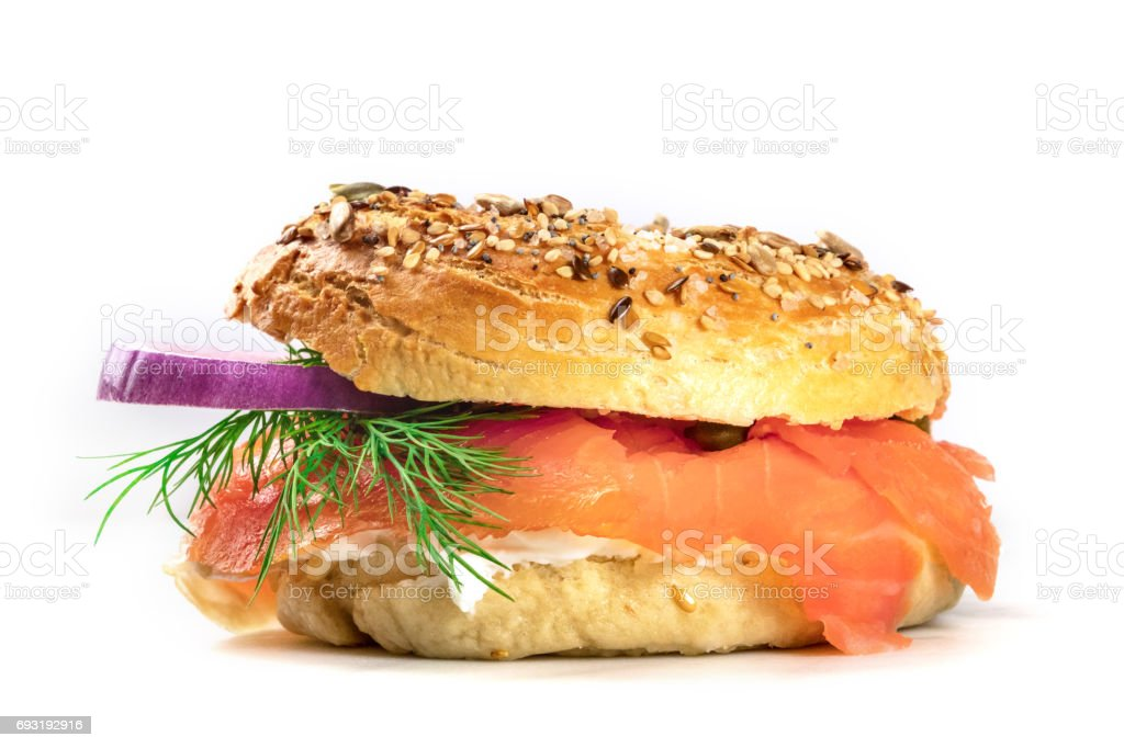 Sesame bagel with cream cheese and lox, on white stock photo
