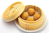 Sesame balls in Chinese bamboo basketRelated images: