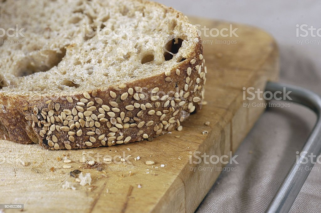 sesame bread sliced on cutting board royalty-free stock photo