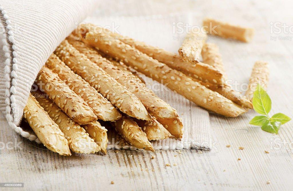 Sesame bread sticks bundled on wooden table stock photo