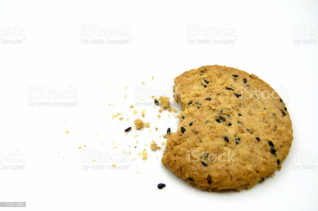 Sesame Cracker with a bite royalty-free stock photo