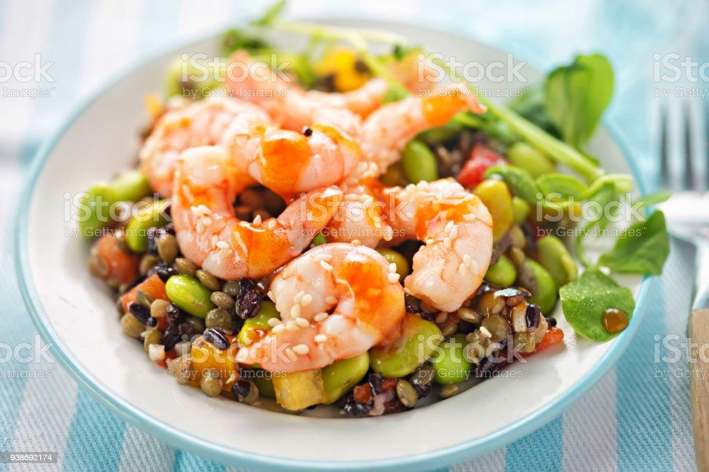 Sesame king prawn and rice salad with teriyaki dressing stock photo