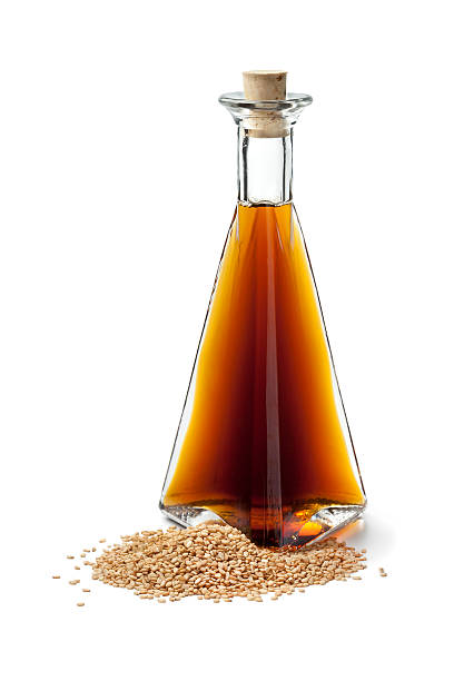 Sesame oil and roasted sesame seeds stock photo
