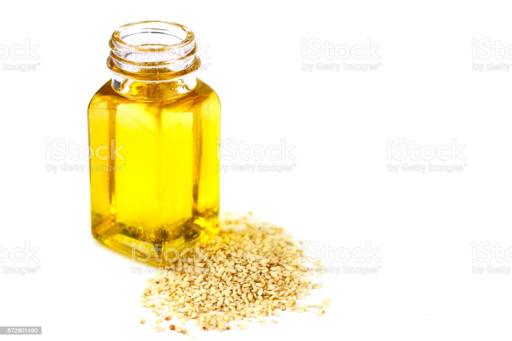 Sesame oil isolated on white background stock photo