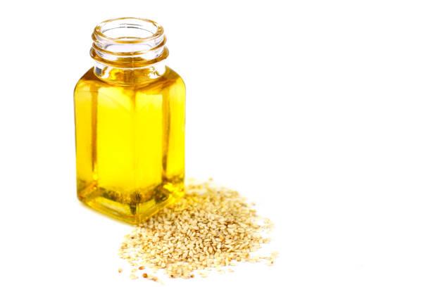 Sesame oil isolated on white background stock photo