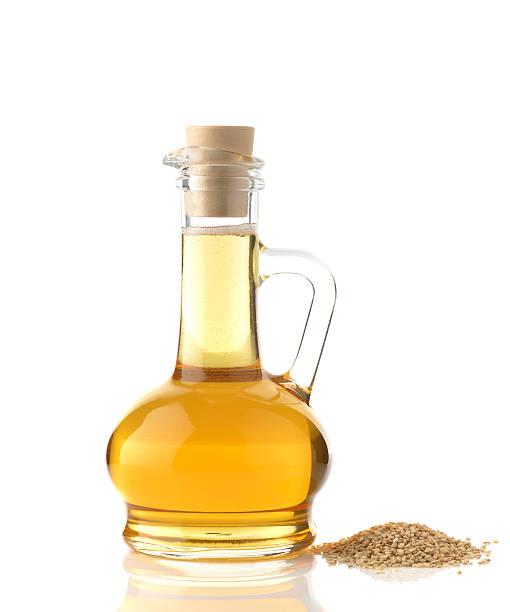 Sesame Oil on White Background stock photo