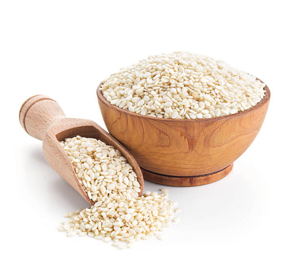 sesame seeds isolated on white - sesame stock photos and pictures