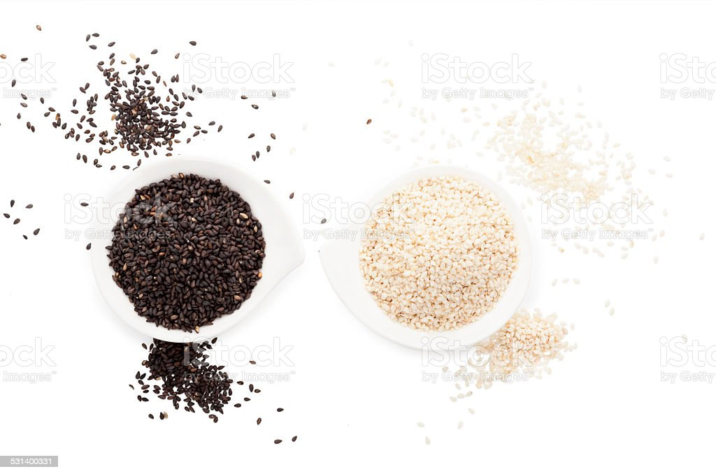 Sesame seeds isolated on white. stock photo