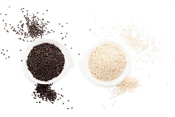 sesame seeds isolated on white. - sesame stock photos and pictures