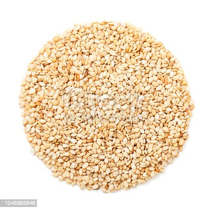 Sesame seeds in circle isolated on white
