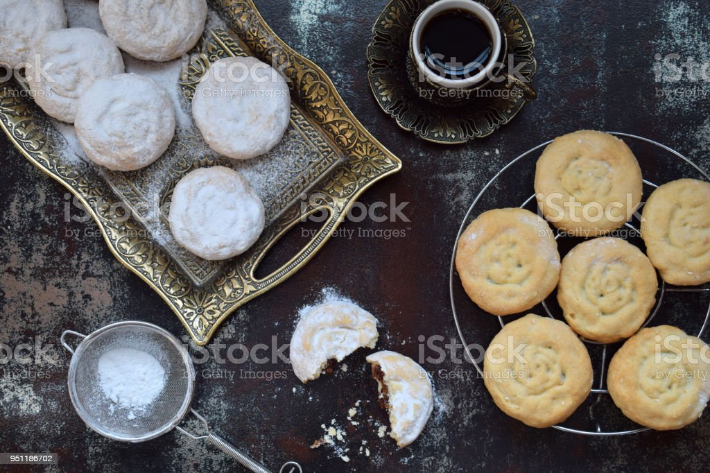 Sesame shortbread with date stuffing. Middle Eastern cookies. Eid and Ramadan Dates Sweets. Kahk. Arabian cuisine. Copy Space stock photo