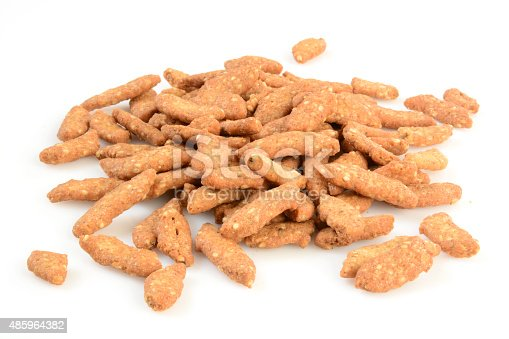 Sesame snack sticks in a mound on a white background