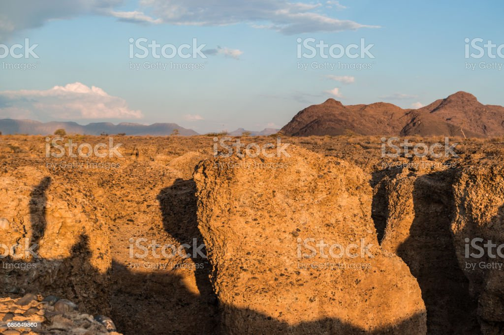 Sesriem Canyon at Sunset with the Shadow of a Person, Sossusvlei, Namibia royalty-free 스톡 사진