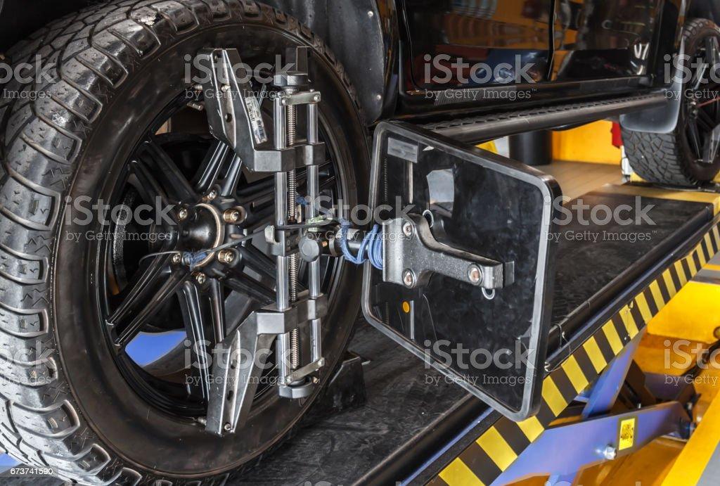 Set against the Center wheel the car stock photo