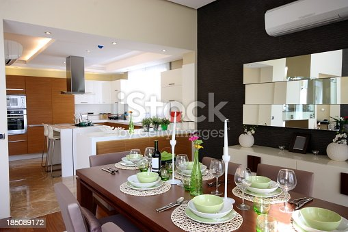 istock Set dining room table next to kitchen in open concept home 185089172