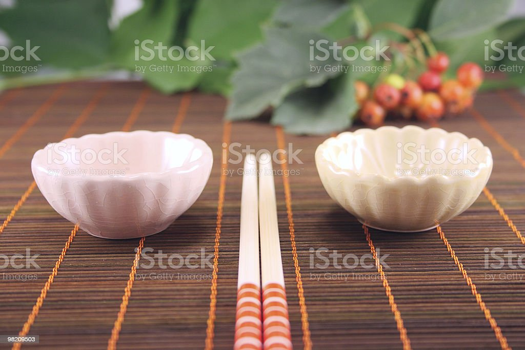 Set for a sushi on bamboo napkin royalty-free stock photo