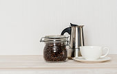 Coffee set with mug, coffee beans and retro coffee machine
