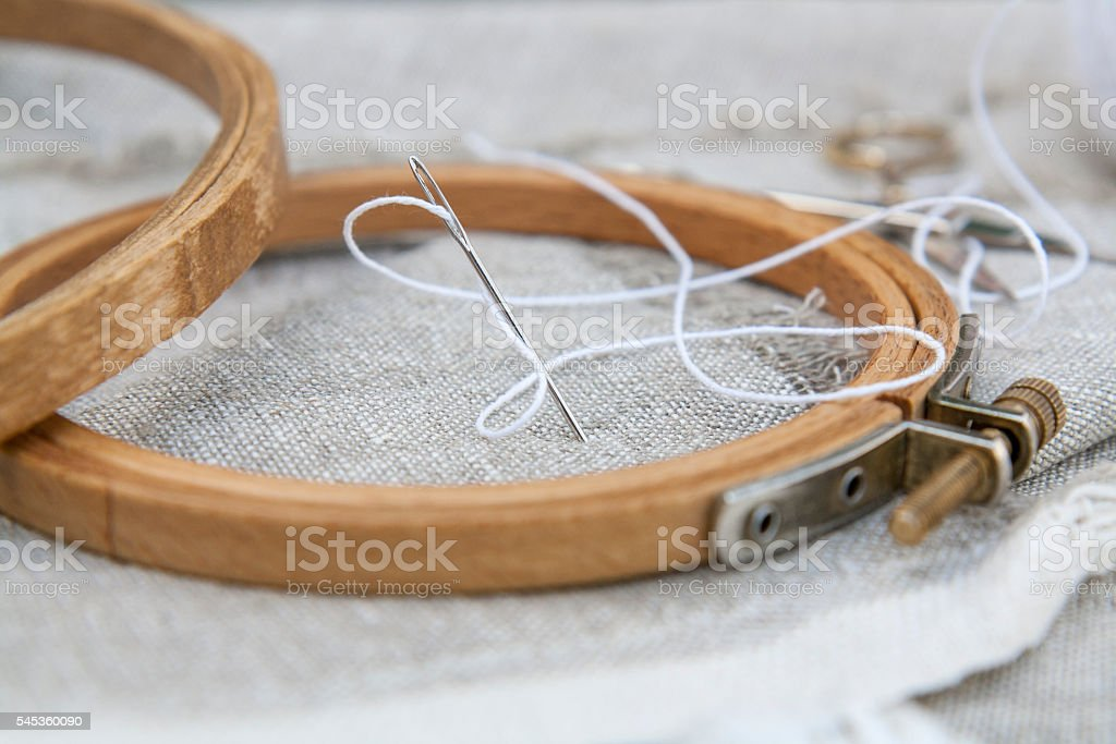 Set for embroidery, garment needle and embroidery hoop royalty-free stock photo