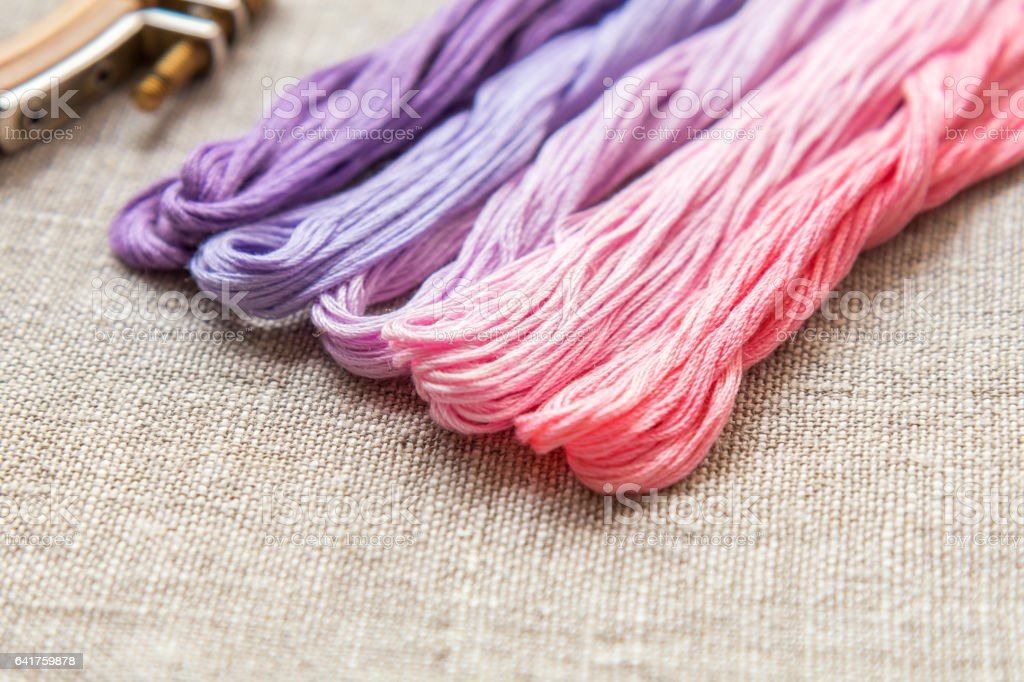 Set for embroidery with thread violet color royalty-free stock photo