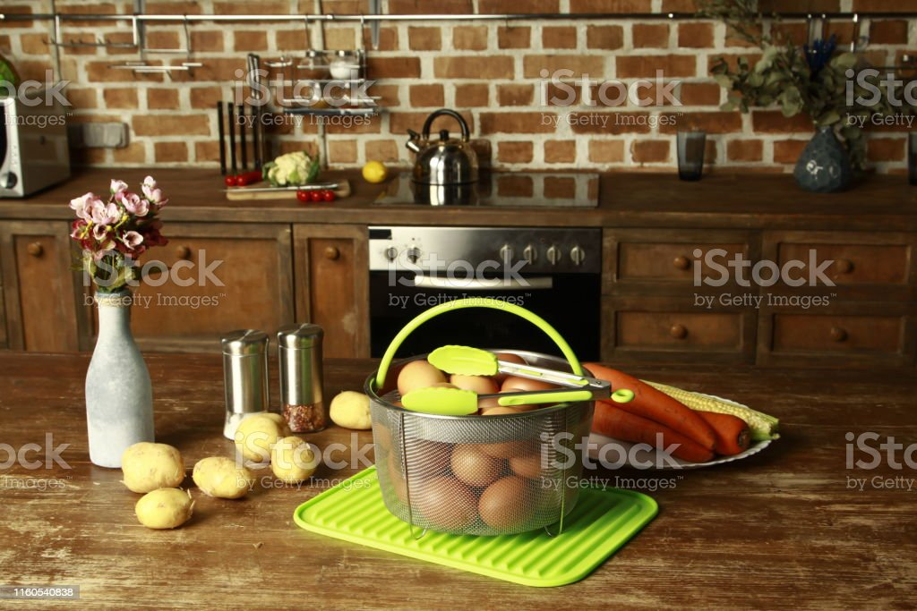 set for kitchen - metal basket, tong and silicone mat